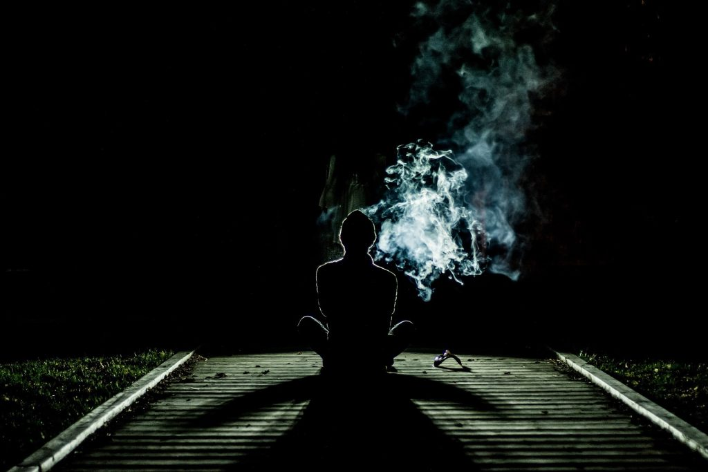 Man meditating smoke