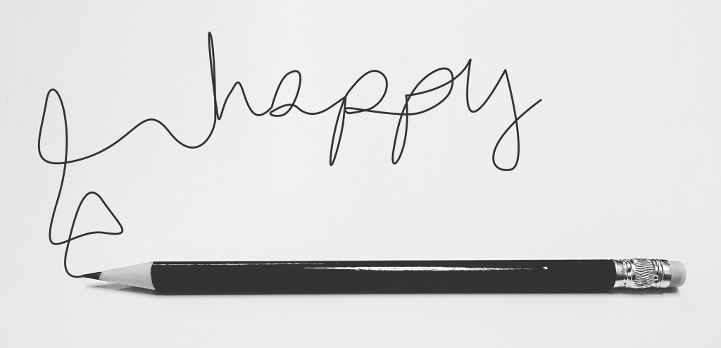 pencil and happy word